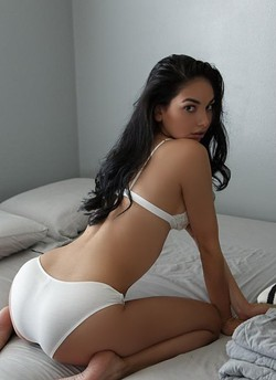 Upscale brunette playmate for any occasion